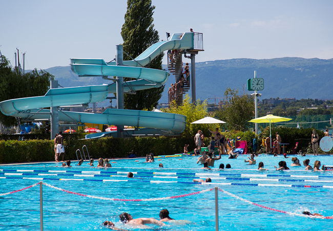 Best Seller Geneve Plage: 10-Entries Card (Valid 7/7, Transferable) Geneva's largest summer resort incl beach access, pools, slides, high-dives, parc & summer activities for kids + adults. Entries valid 7/7 from July 15 onwards  Photo