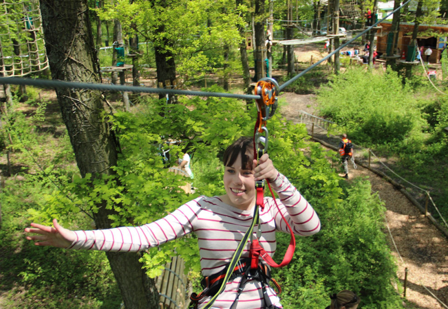 Recommended by 98% of Buyclubbers  2 Passes to Parc Aventure Geneva Rope-Park for Adults & Kids from Age 5+, Valid 7/7 All Summer  A great family day out swinging from tree tops, crossing obstacles, climing webs & more  Photo