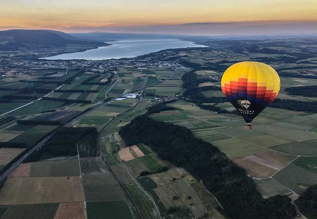 Once In A Lifetime Experience!  Hot Air Balloon Ride from Geneva / Rolle / Lausanne / Gstaad / Fribourg with BALLONS du LEMAN   Each voucher valid for 1 person Use anytime over next 2 years      Photo