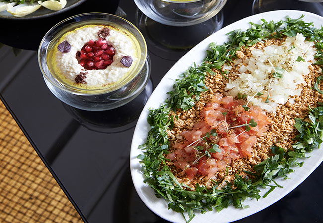 """A Cascade of Tantalizing Dishes"" - Gault&Millau