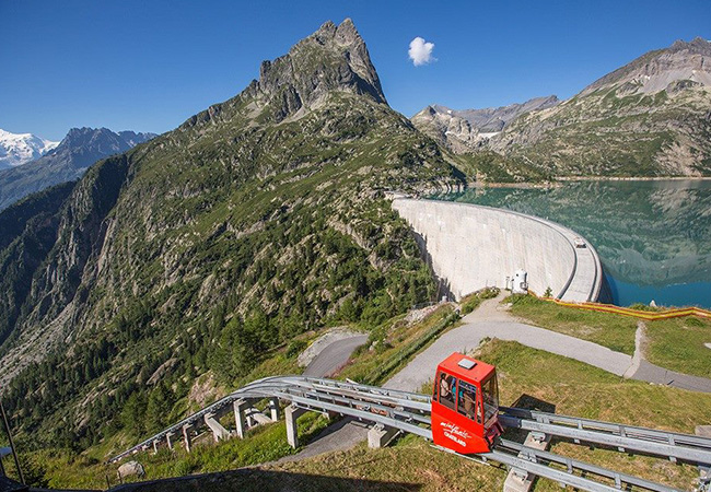 Tripadvisor Cert. of Excellence Switzerland's Best: Mountain Rail-Cars Trip to the Emosson Dam in Valais (Family Friendly) with VerticAlp EmossonRide the world's steepest double-decker funicular 2000 meters up with stunning views of Mont Blanc & the Emosson dam, and stop to trek if you want. 1h35 from Geneva, 1h20 from Lausanne  Photo