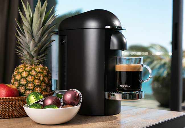 Nespresso Vertuo​Plus Deluxe Black Coffee Machine + 100-. Capsule Credit + Travel Mug