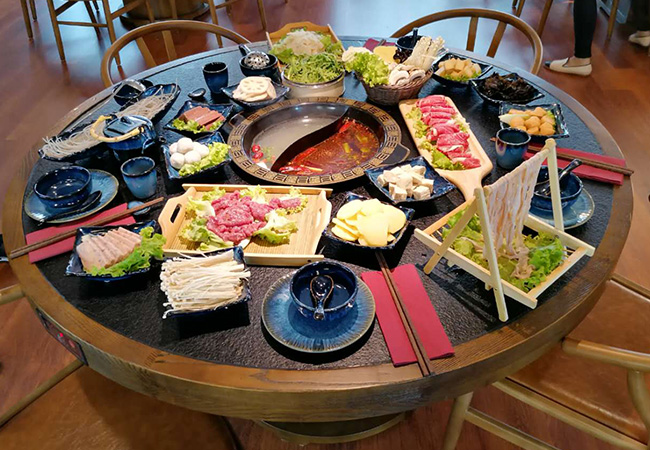 4.8 Stars on Google  Seafood & Meat Chinese Fondue for 2 at Zhou Yu (Pâquis)  Cook your own meats (seafood, beef & chicken) & vegetables right at your table by dipping them into the hot broth. Valid dinner & lunch Tue-Sat  Photo